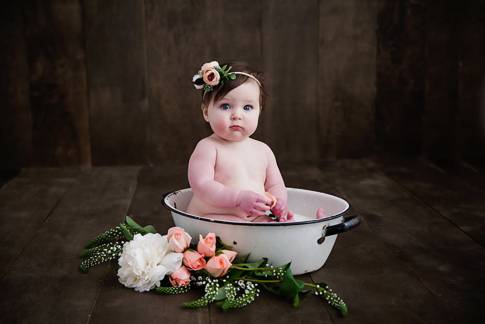 baby girl in a milk bath