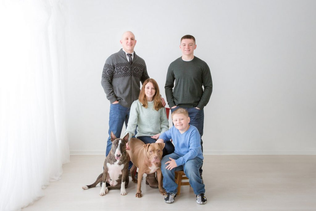 posed family photo including two dogs