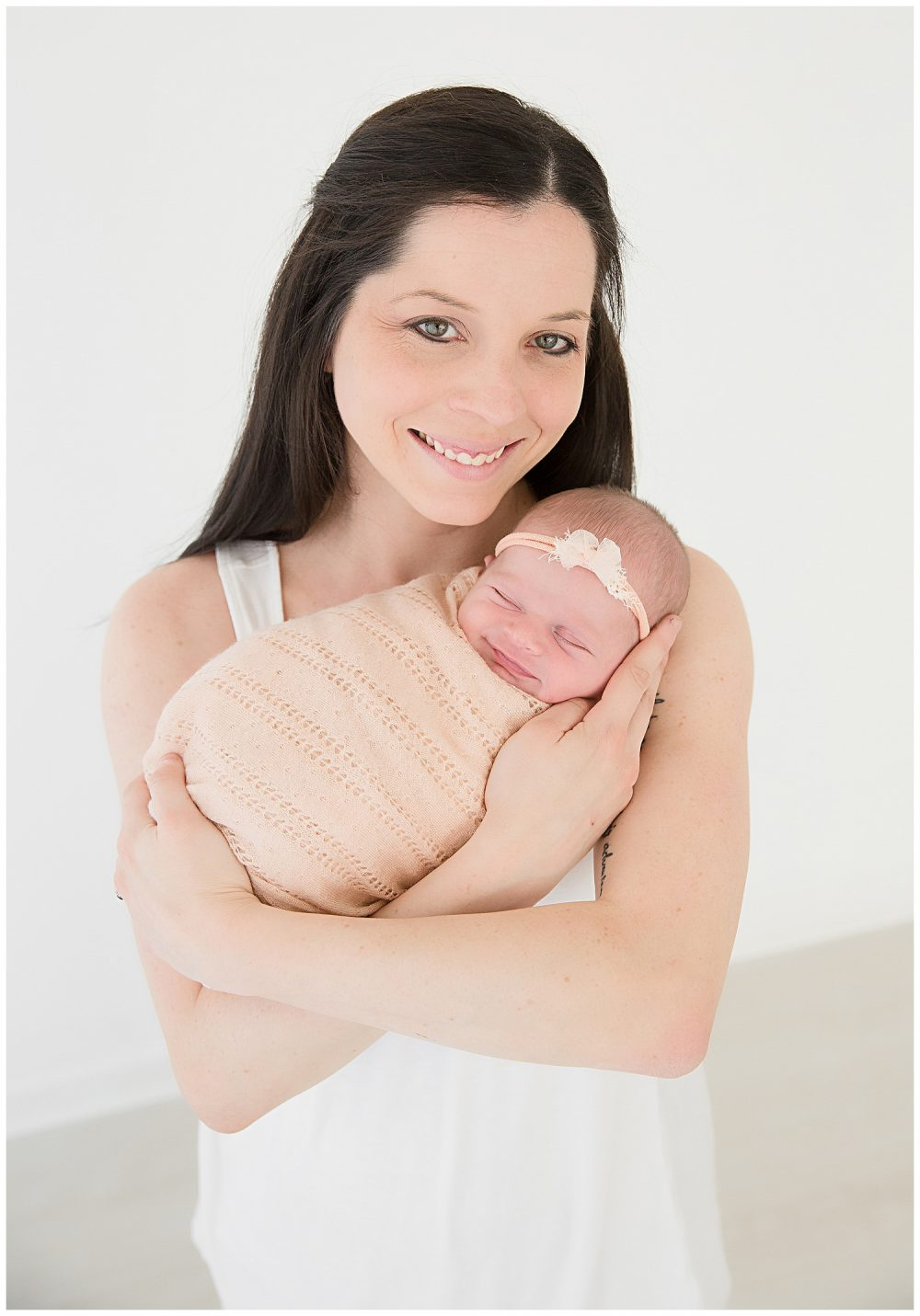 mom+holding+her+baby+girl+smiling
