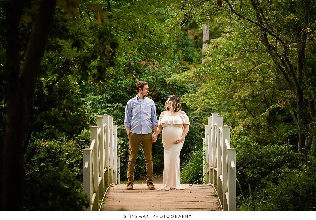mom and dad looking at camera during maternity pics