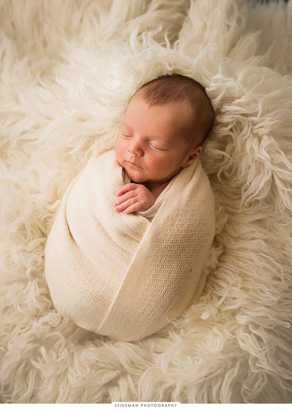 potato sack pose for newborn photography