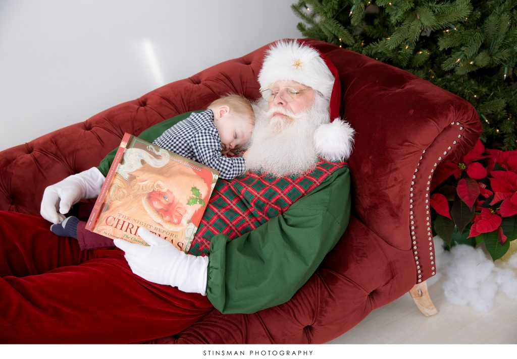 santa sleeping with baby boy on his chest