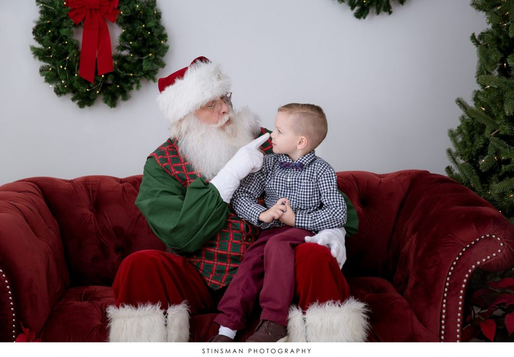 santa looking at child smiling