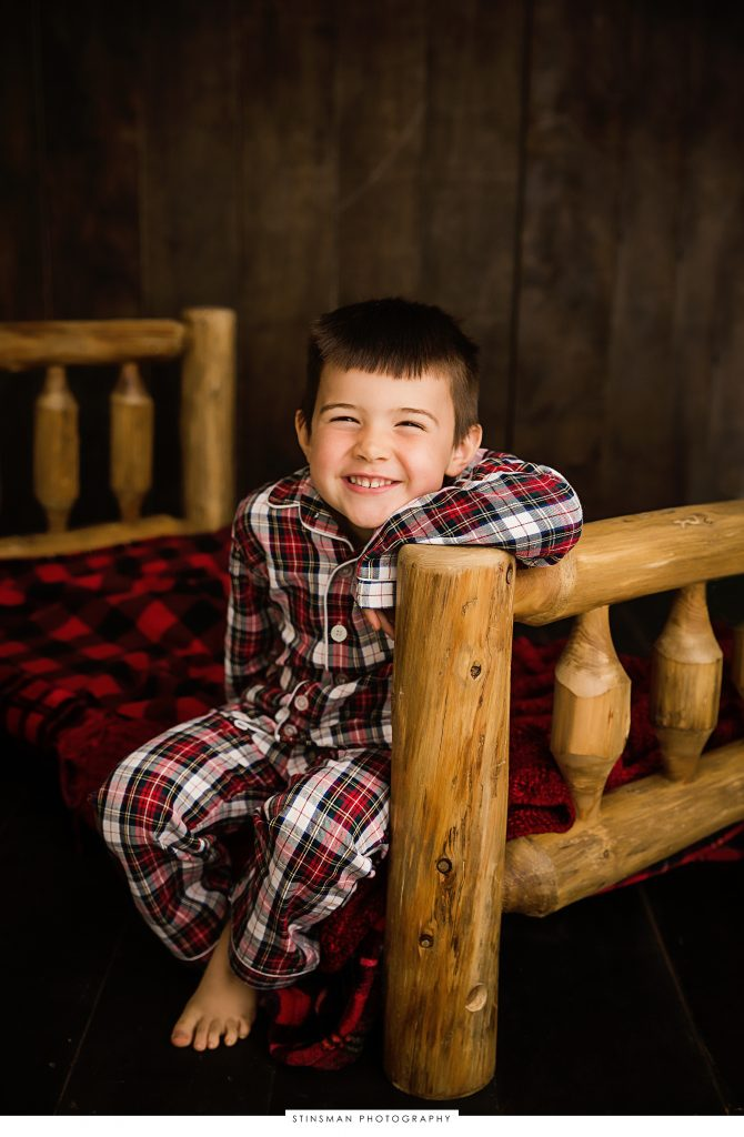 smiling little boy in pajamas