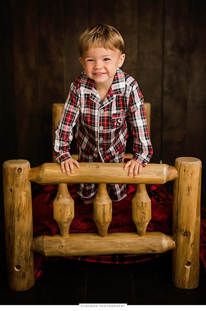 rustic bed with little boy jumping