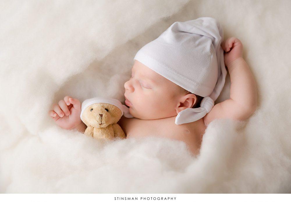 sleeping baby girl with teddy bear