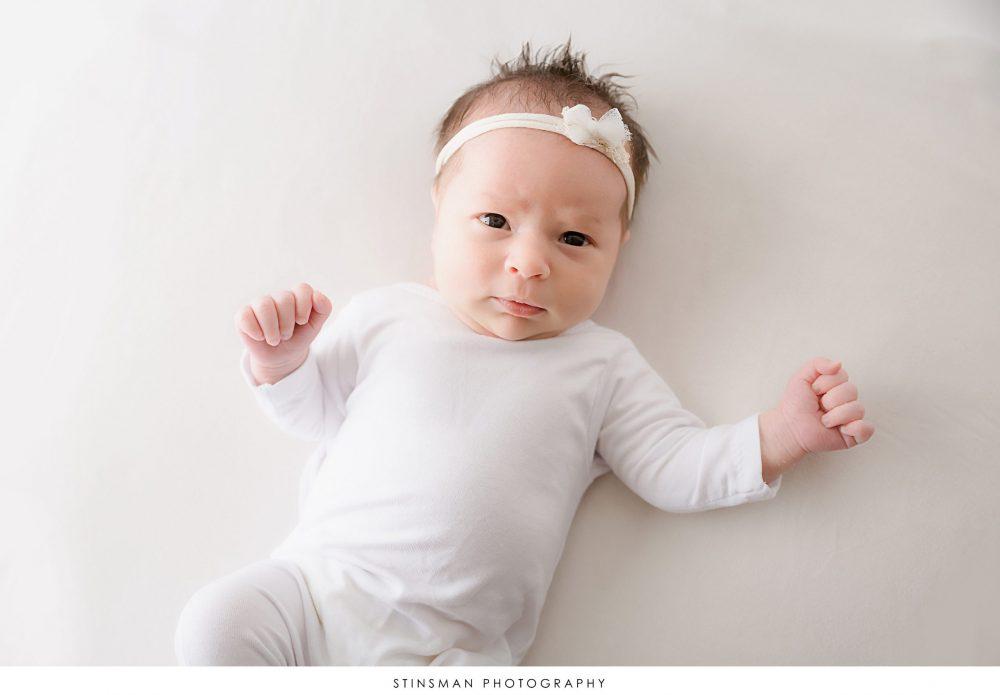 awake 2 week old baby girl in south jersey studio