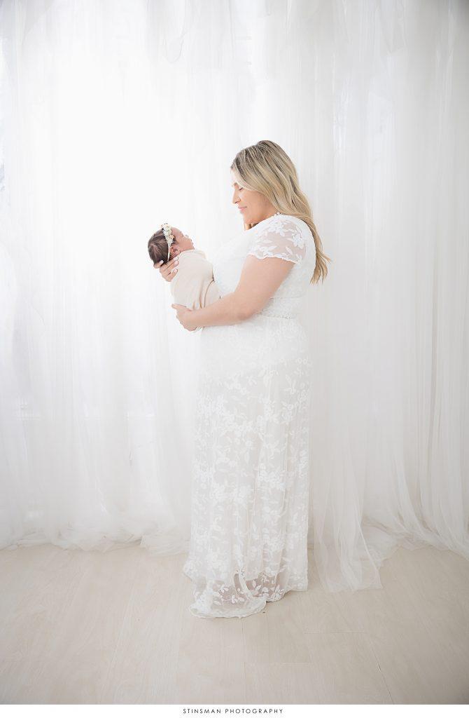 new mom holding baby girl