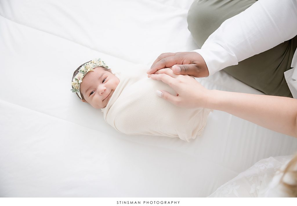 baby girl smiling at the camera