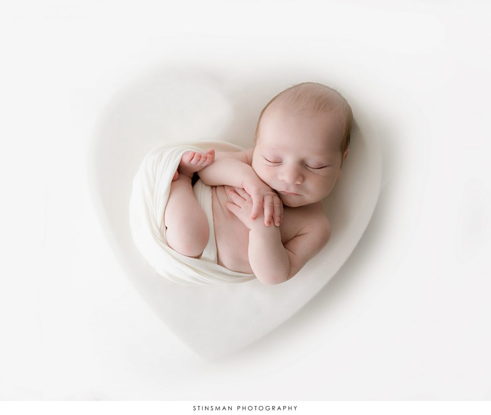 newborn photo with baby in a heart