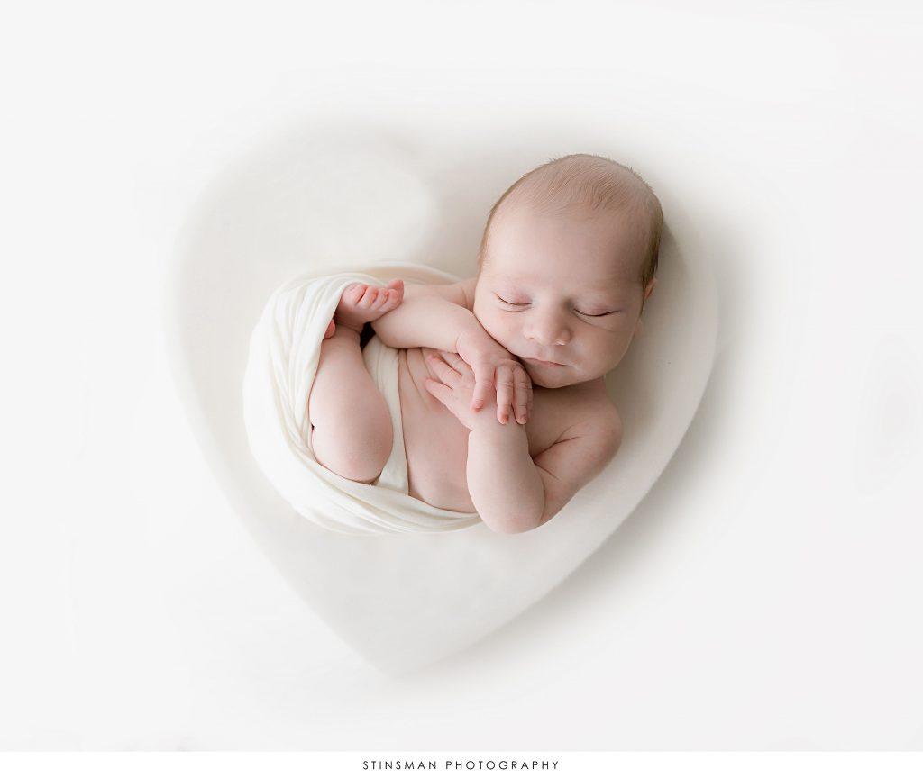 Newborn baby boy in a heart