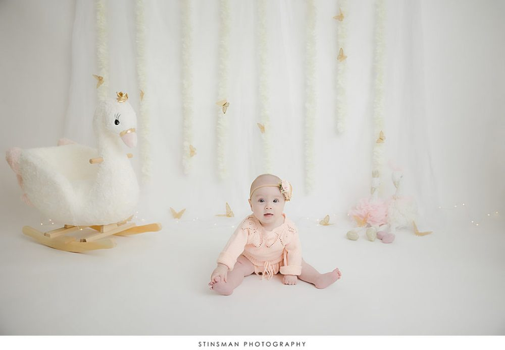baby girl at her half birthday milestone photoshoot