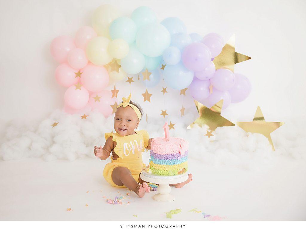 Baby girl smiling at her cake smash in southampton nj photo studio