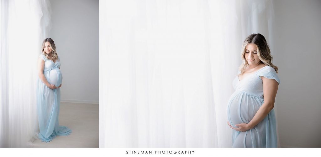 Pregnant mother in blue gown at her maternity photoshoot