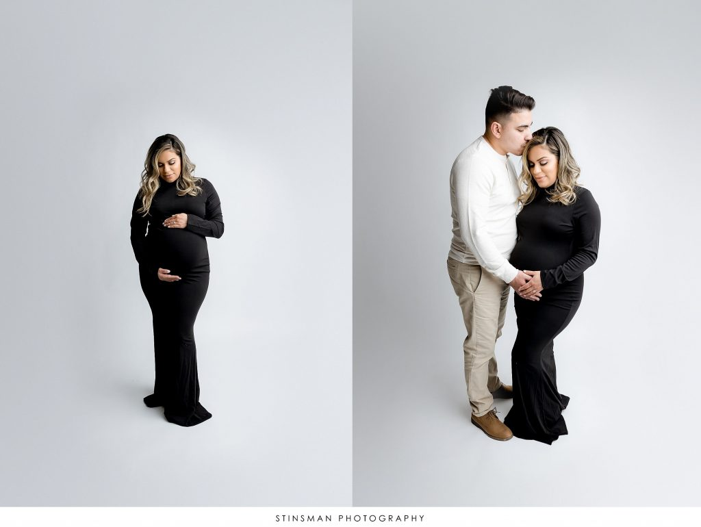 Husband and wife in black gown at their maternity photoshoot