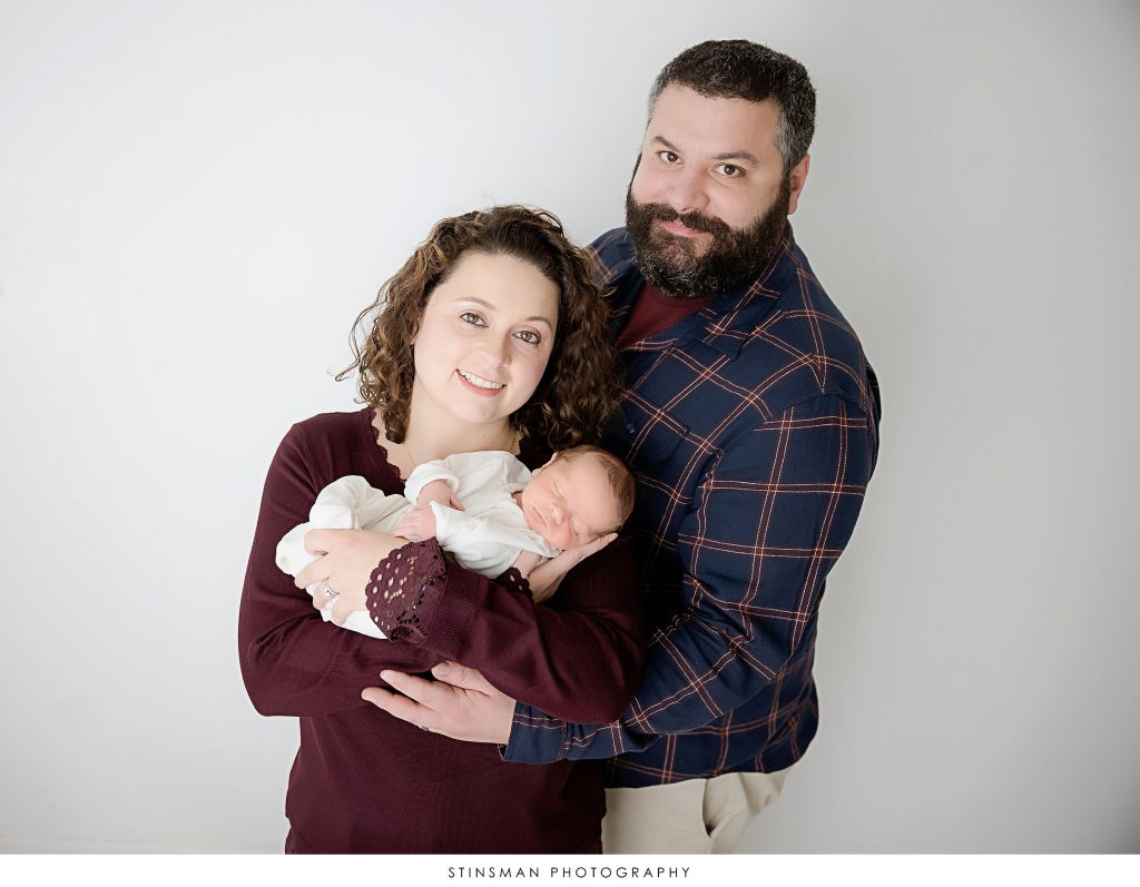 Parents with their newborn son at their newborn photoshoot