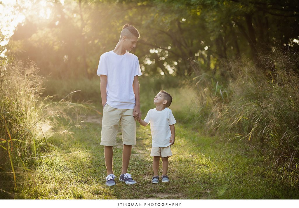 Brothers holding hands at their family photoshoot