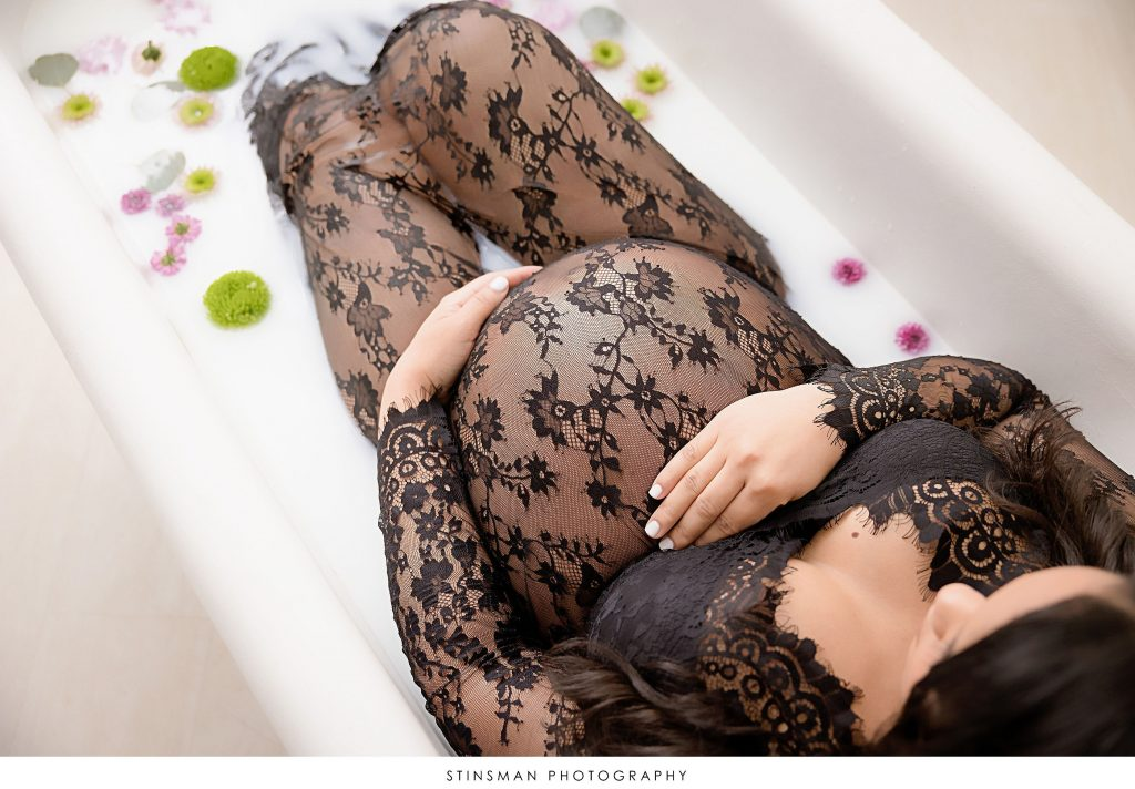 Pregnant mom in a milk bath at her maternity photoshoot