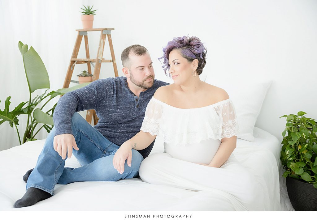 Parents to be snuggling at their maternity photoshoot