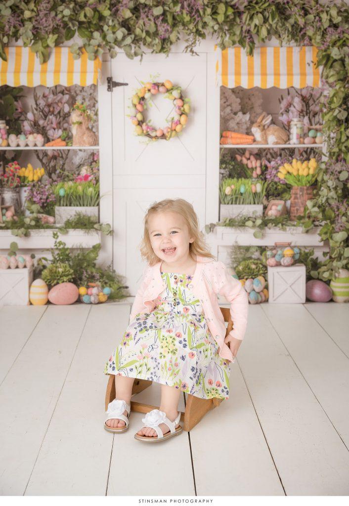 Little girl posing at her mini Easter photoshoot