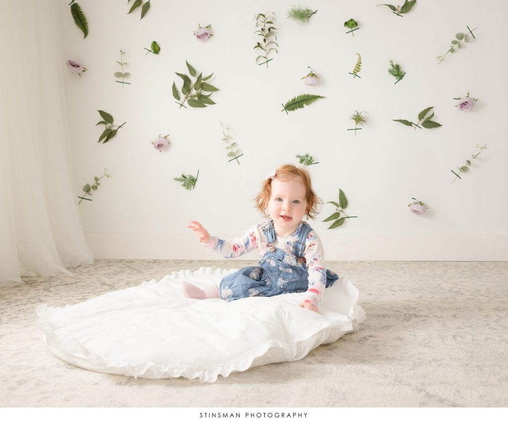 Little girl posed at her spring mini photoshoot