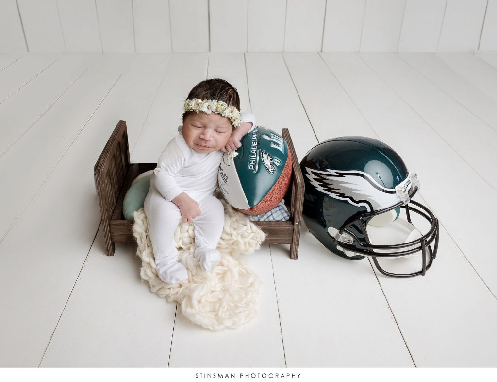 Newborn baby girl posed in a composite photo at her newborn photoshoot