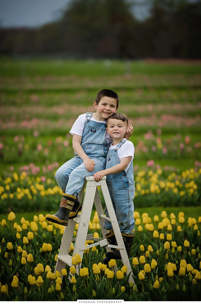 Brothers posing at their tulip mini photoshoot