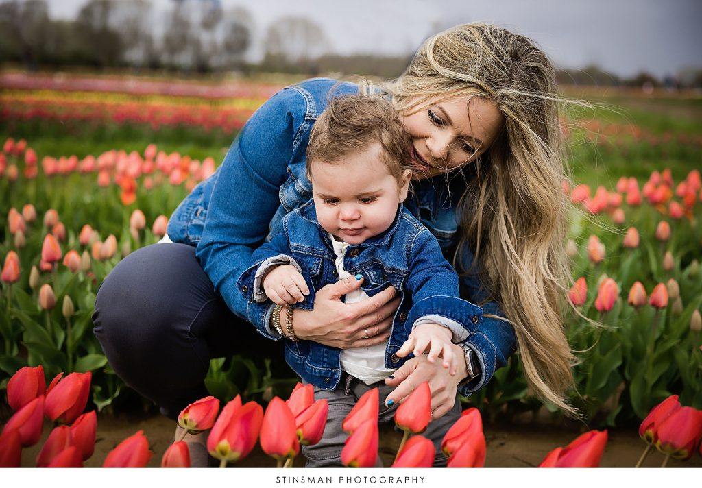 Mother and son looking at flowers at their tulip mini photoshoot