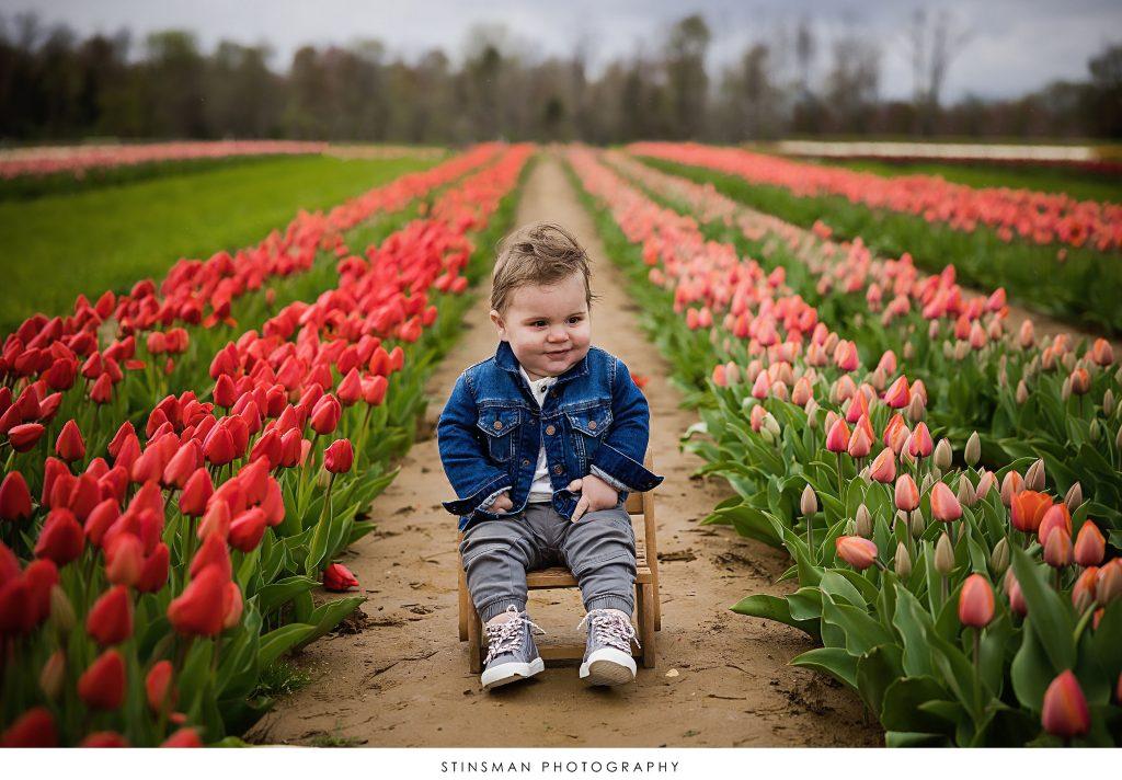 Baby boy smiling at his mini tulip photoshoot