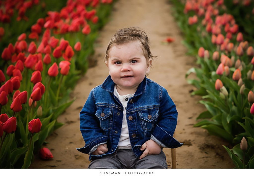 Close up of a baby boy at his tulip mini photoshoot