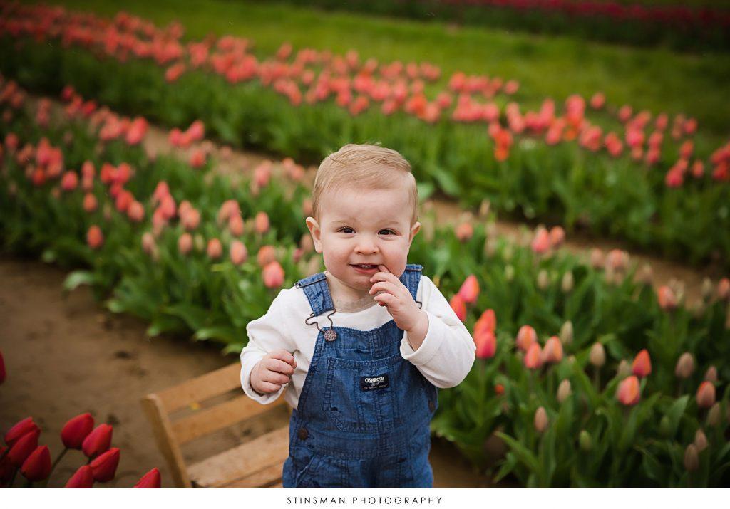 Baby boy looking at the camera at his mini tulip photoshoot