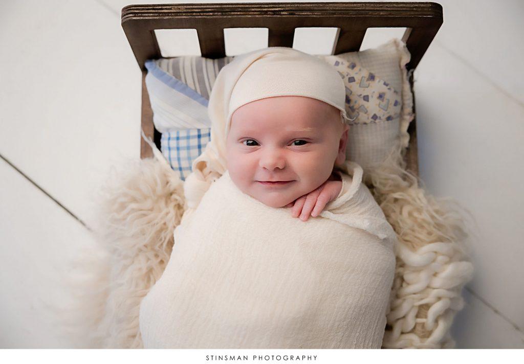 Newborn baby boy alert at his newborn photoshoot