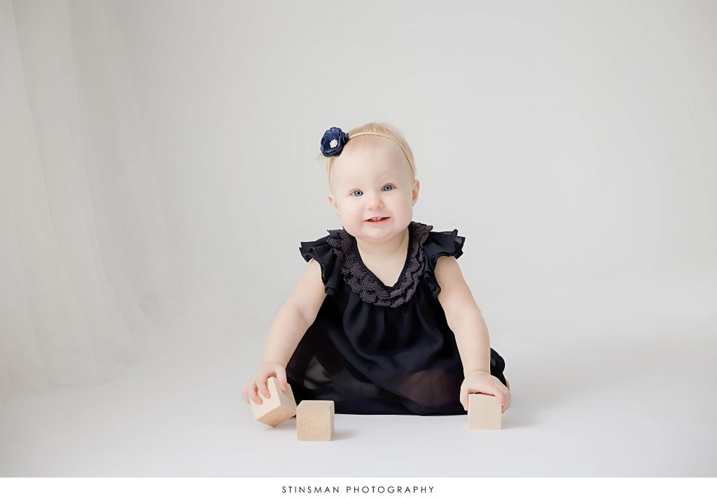 baby girl at her 1st birthday milestone photoshoot