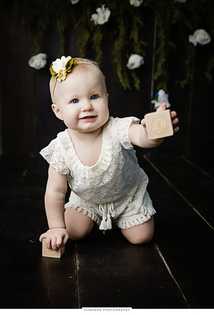 Baby girl smiling at her first birthday photoshoot