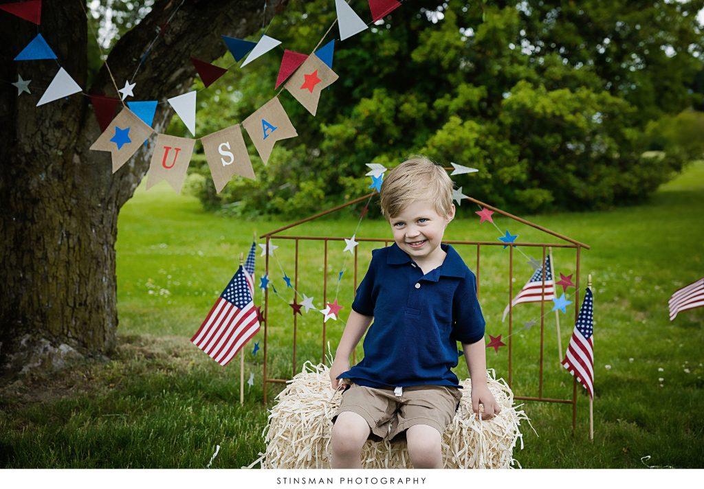 Little boy posing for his usa mini photoshoot