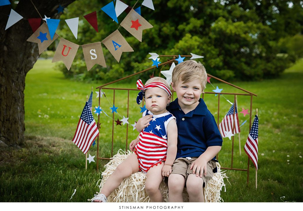 Brother and sister smiling at usa mini photoshoot