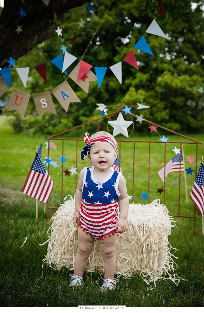 Little girl posing for her usa mini photoshoot