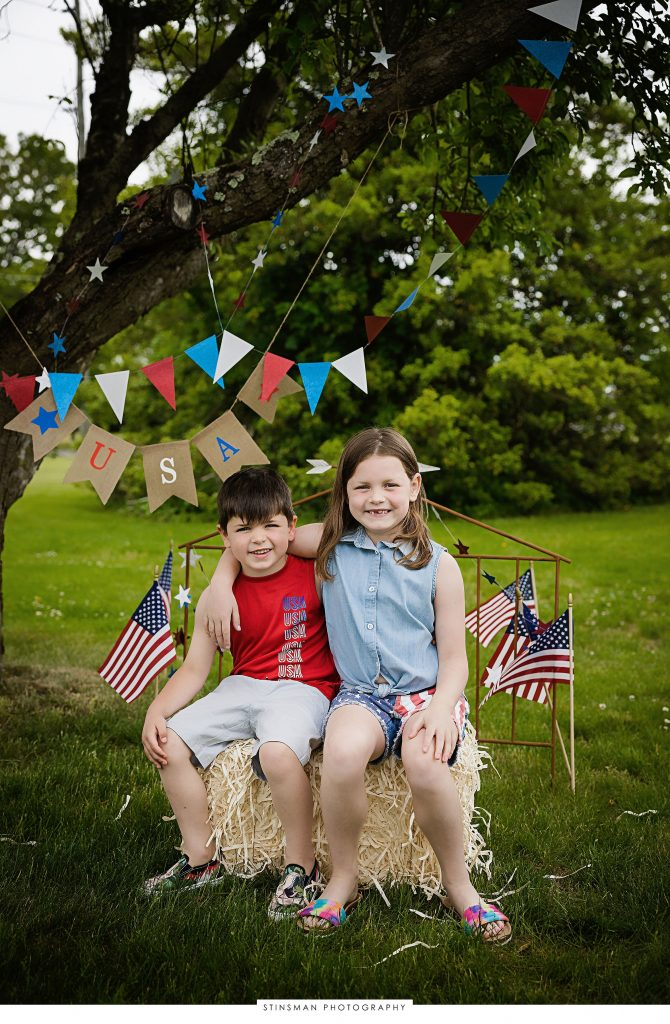 Brother and sister posing at their usa mini photoshoot
