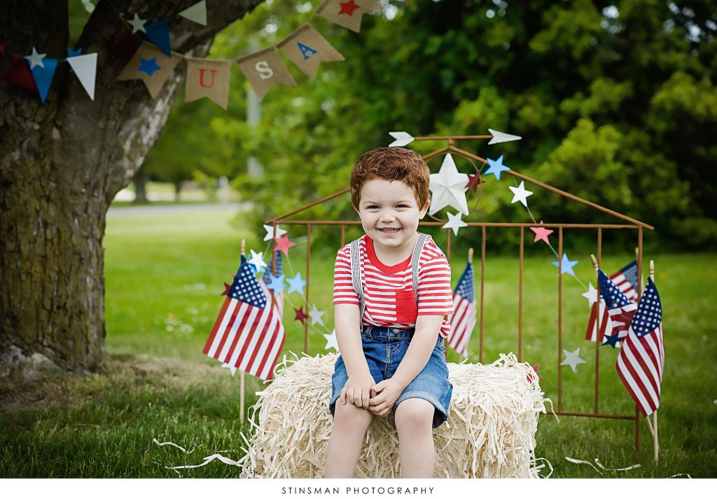 Little boy posing at his usa mini photoshoot