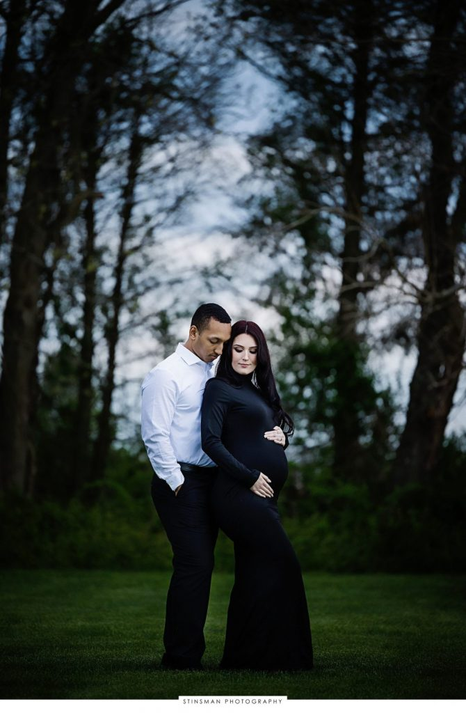 Pregnant mom and dad to be posing outside at their maternity photoshoot