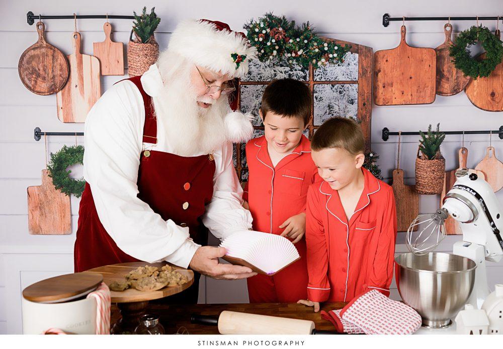 boys in red looking at santa naughty or nice list