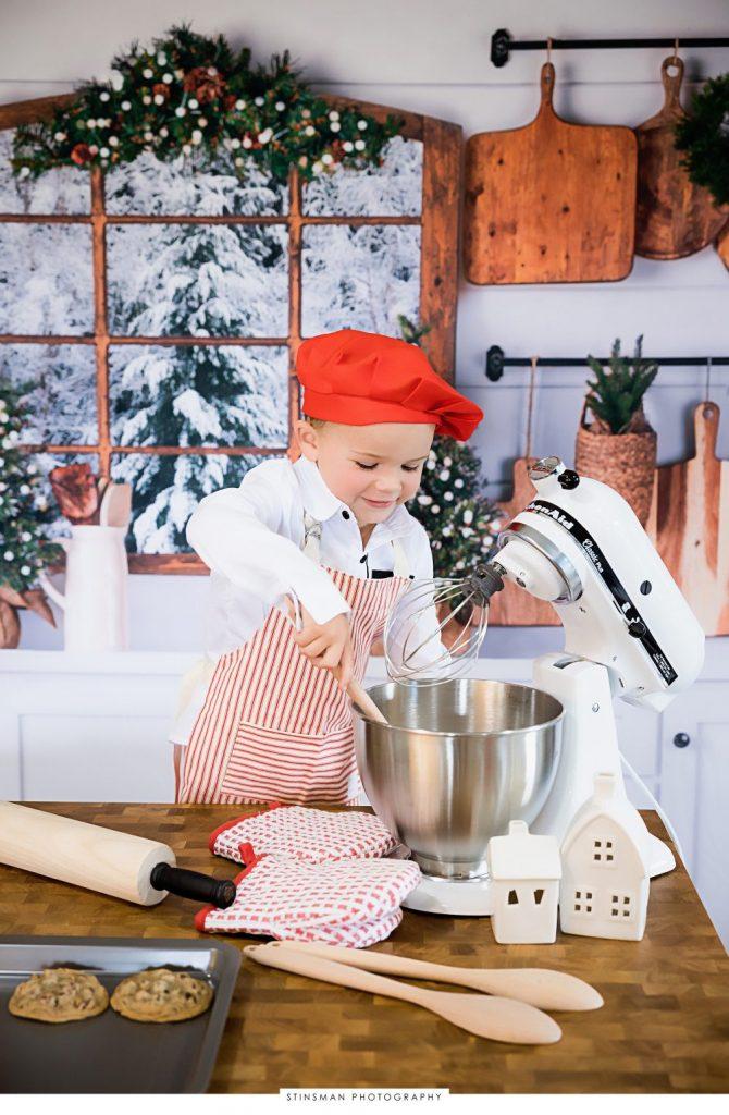 little boy pretending to mix cookie batter