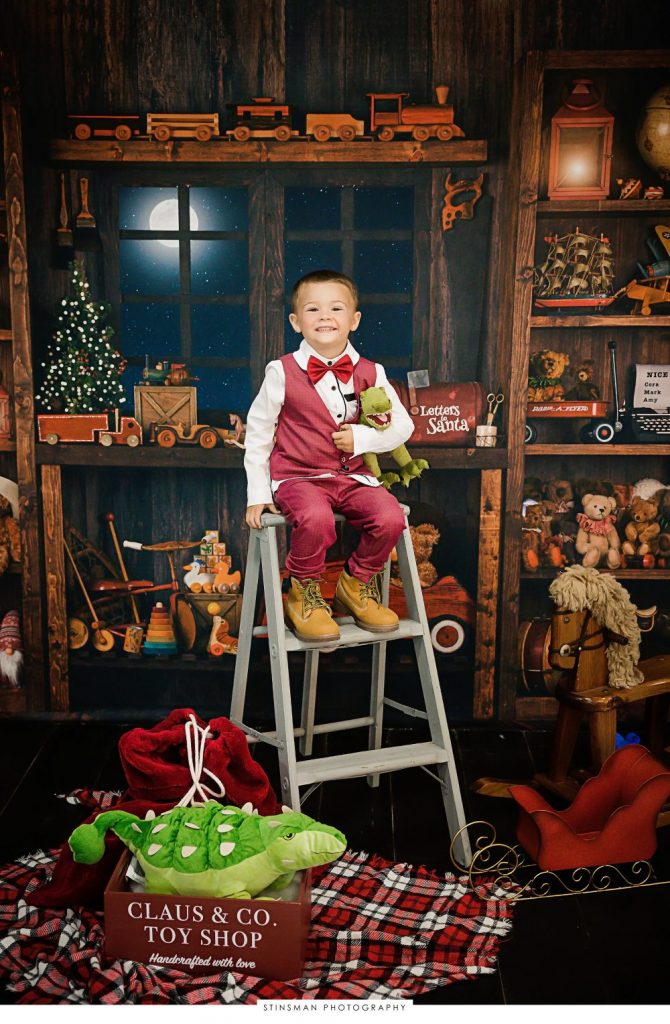 little boy wearing red for his holiday photo shoot
