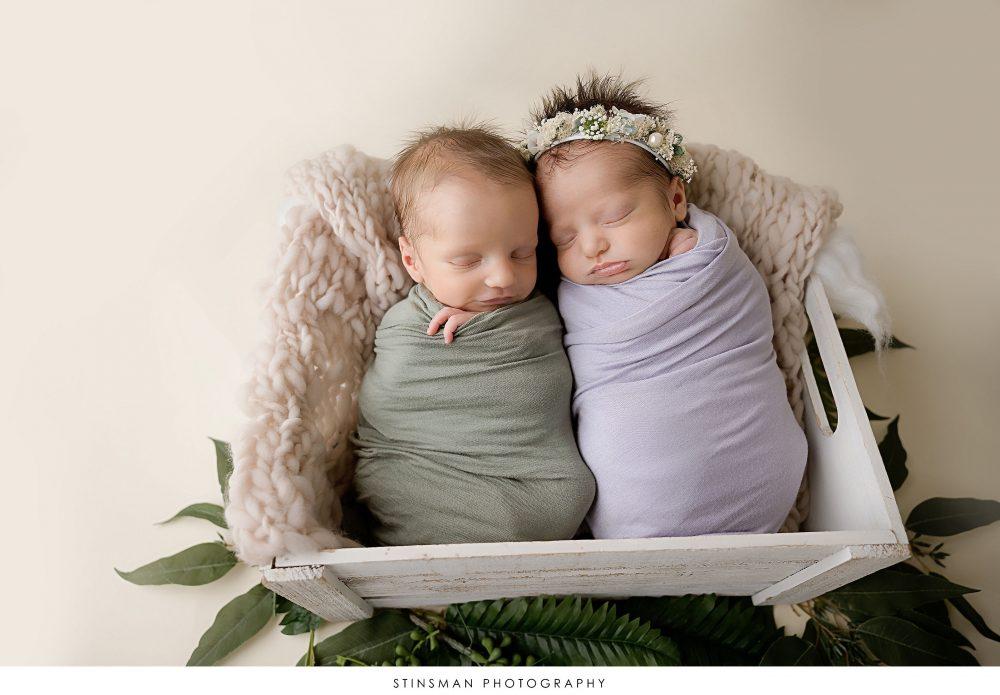 Newborn boy and girl twins posed at their newborn photoshoot