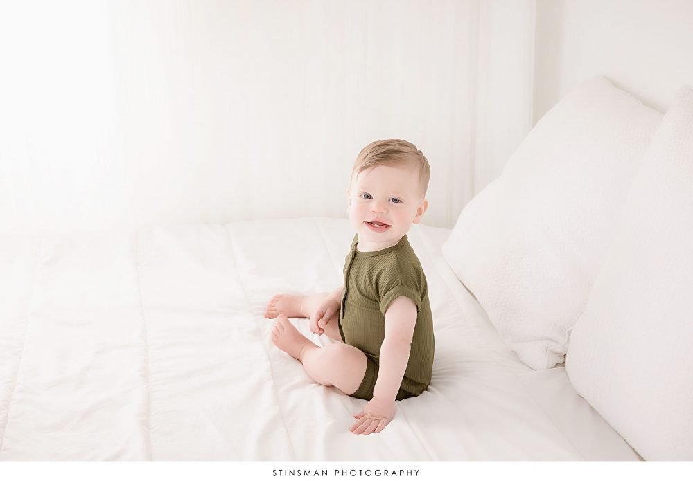 One year old little boy posing at his milestone photoshoot