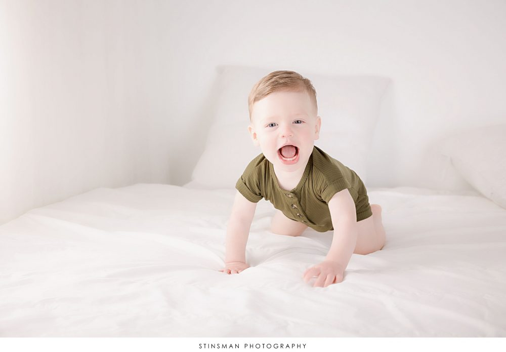 One year old little boy playing at his milestone photoshoott