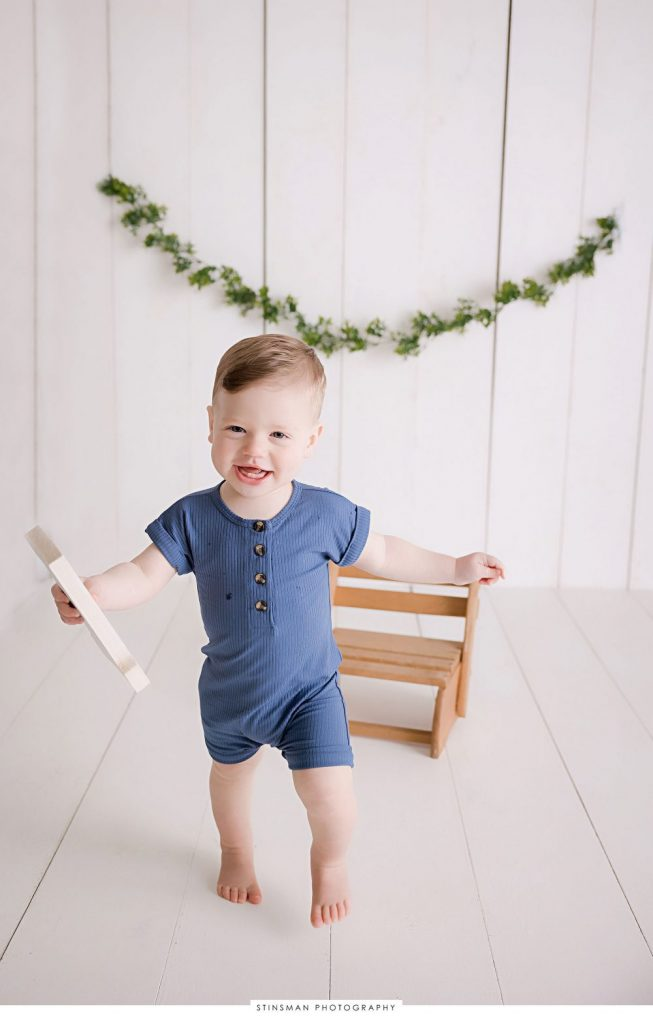 One year old boy posing at his milestone photoshoot