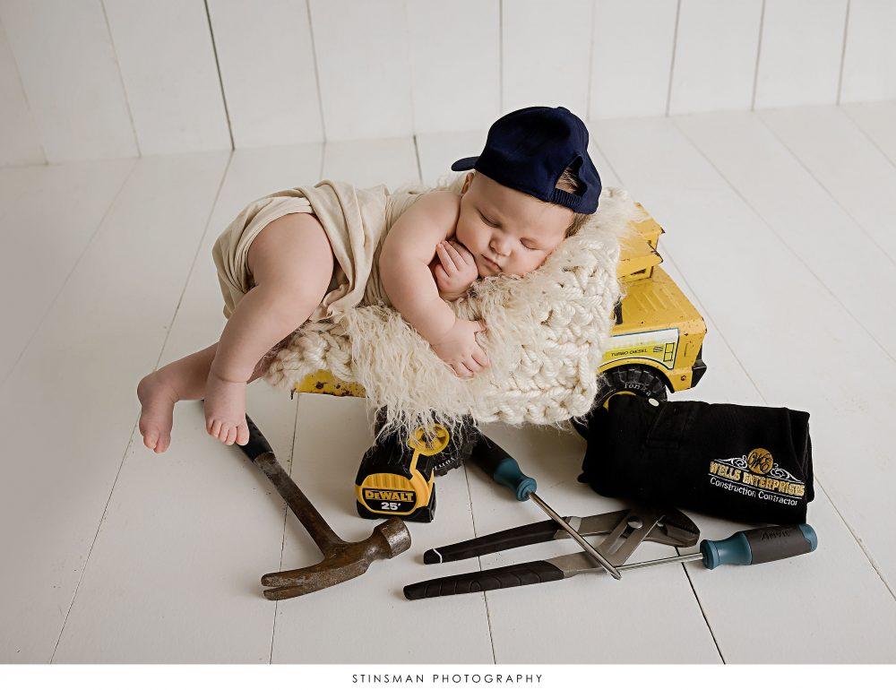 Newborn baby boy asleep at his newborn photoshoot